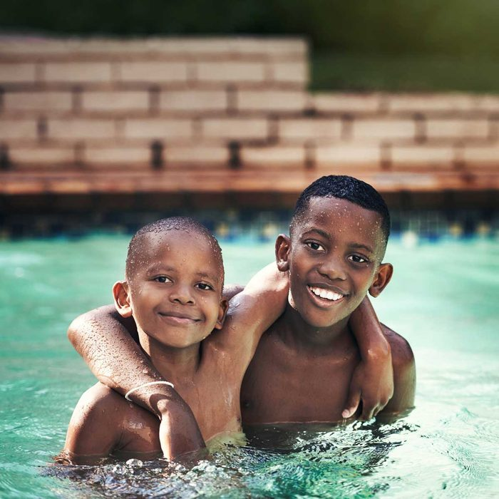Two brothers playing in a pool