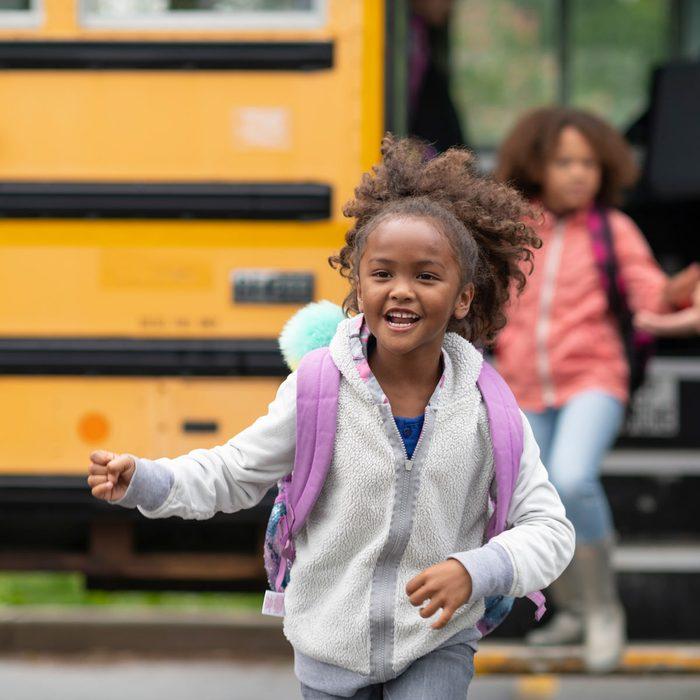 Girl getting off a school bus