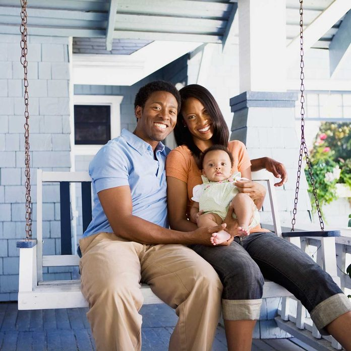 Family on a porch swing
