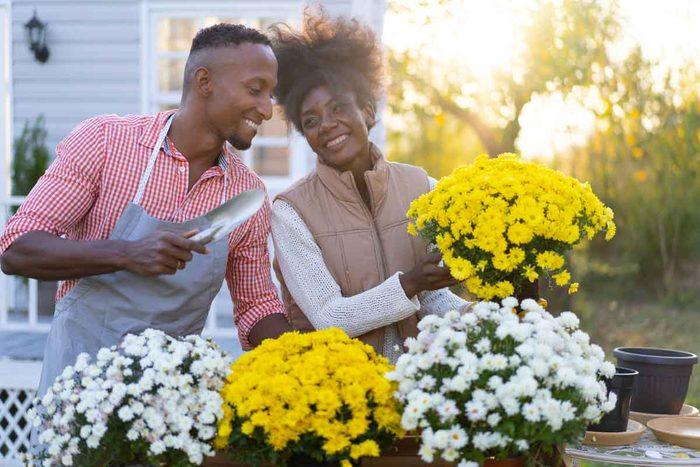 Couple Gardening In Fall