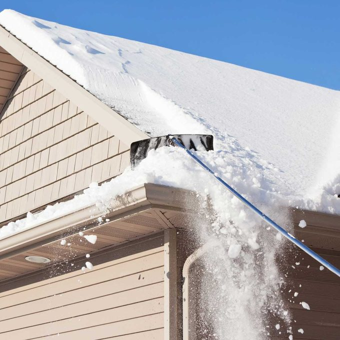 roof rake pulling snow from roof