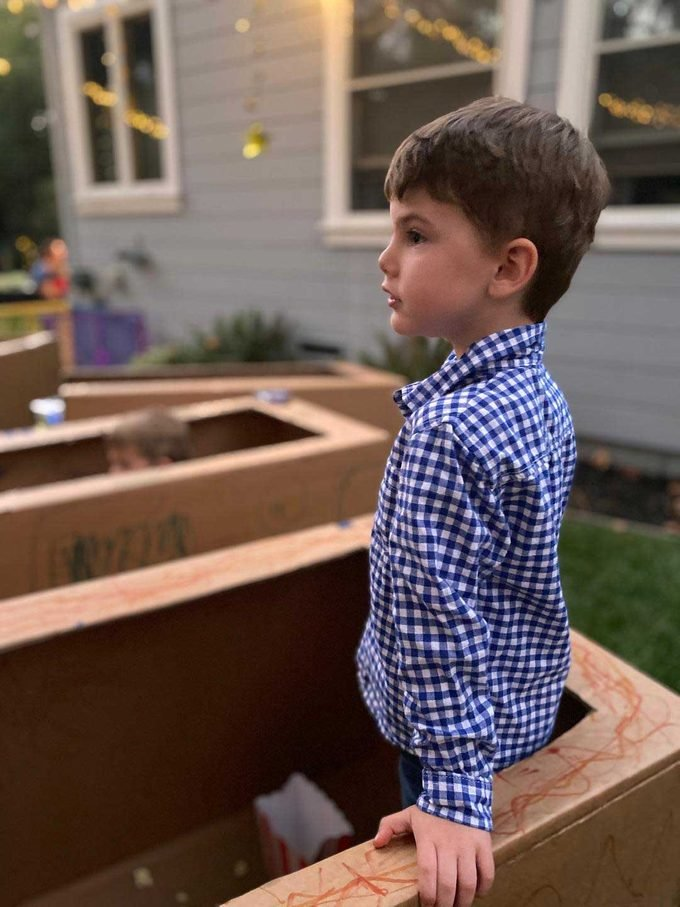Child standing in a box