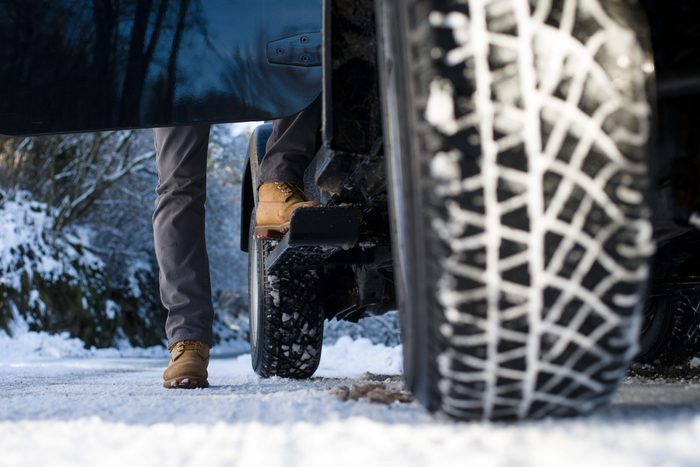 Ground View Of A Jeep Tyre On A Snow Covered Road