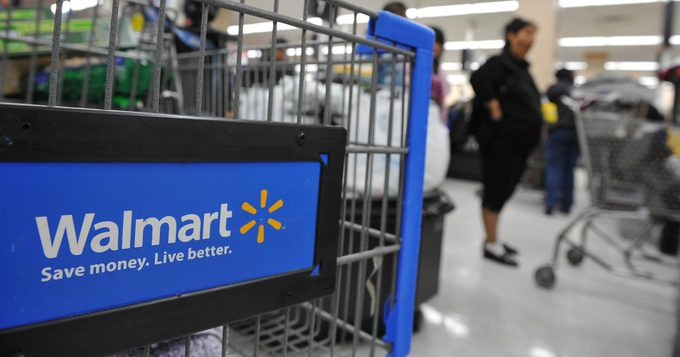 Shoppers wait in line to pay for their purchases at a Walmart store in Los Angeles, California on November 24, 2009, a few days before 'Black Friday' the day after Thanksgiving which kicks off the holiday shopping season. Retailers are hoping 'doorbuster' deals will stimulate sales despite the weak economy. AFP PHOTO / Robyn Beck (Photo credit should read ROBYN BECK/AFP via Getty Images)