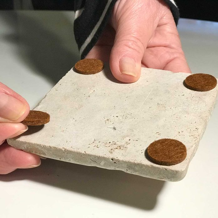 attach stick pads on tile