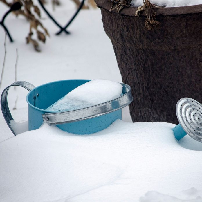 Snowy watering can
