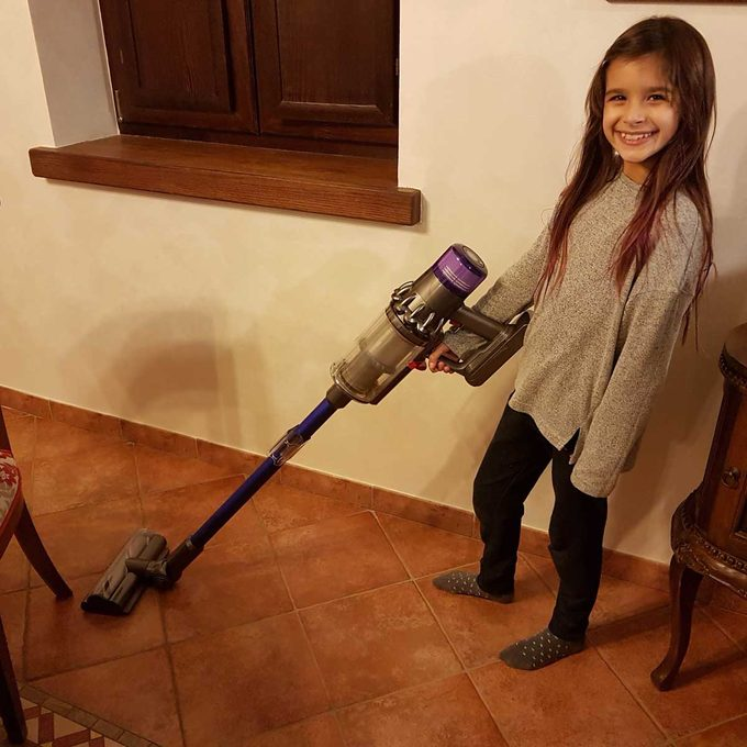 Girl using a Dyson vacuum