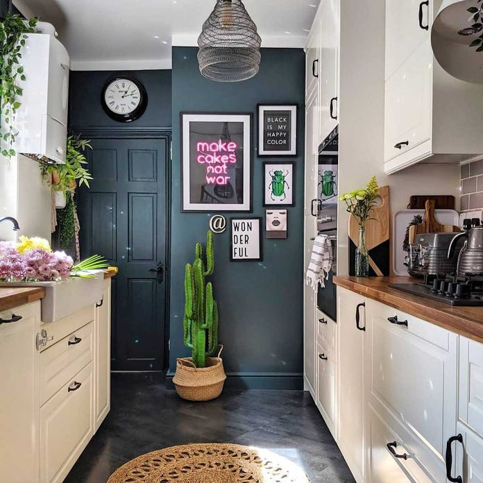 Kitchen with a dark accent wall