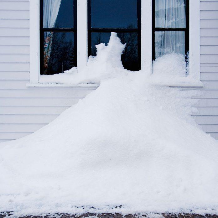 Snow piled against a house