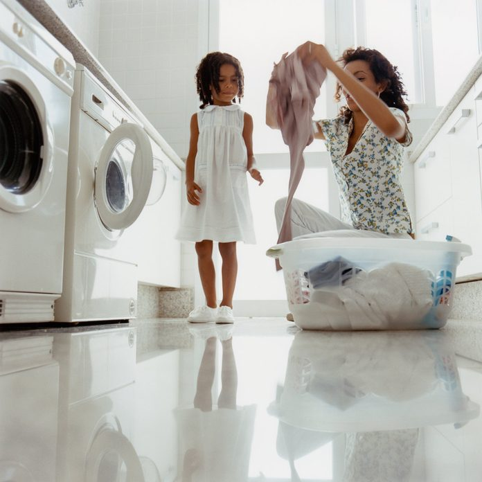 mother and daughter Doing Laundry basket Gettyimages A0130 000158a
