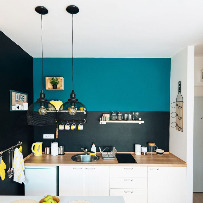 Kitchen with bright blue paint above the shelves