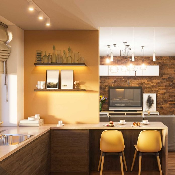 Small kitchen with a yellow accent wall
