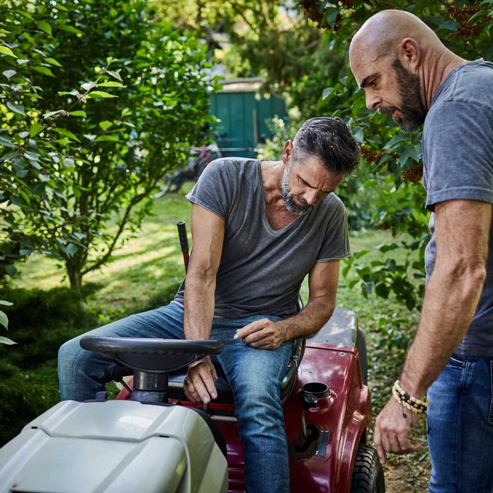Men Fixing Lawn Tractor Gettyimages 1071680788