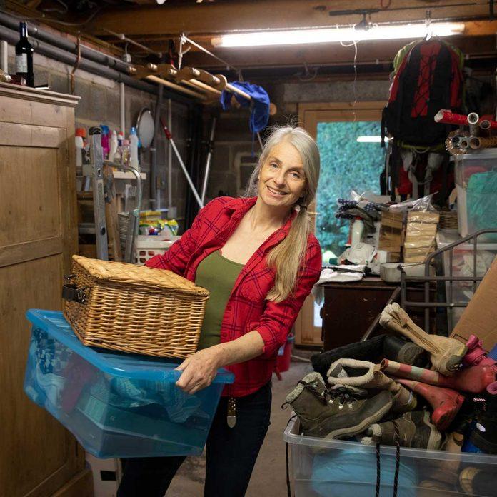 Woman sorting through garage clutter