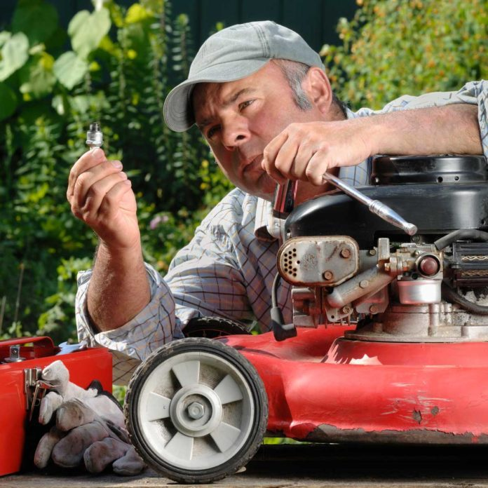 Lawn Mower Spark Plug Gettyimages 109727606