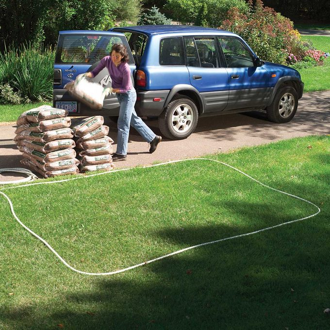Removing mulch bags from vehicle