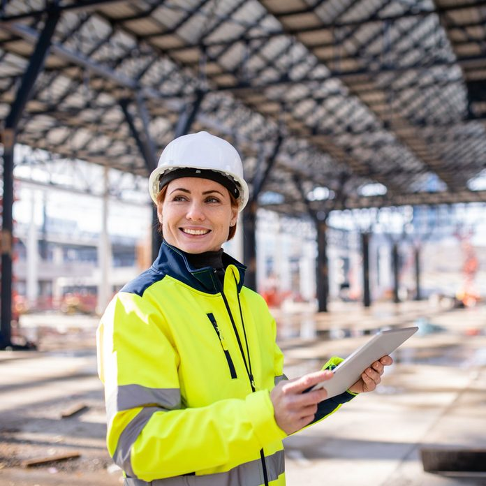 Woman wearing a Construction Jacket Gettyimages 1203569759