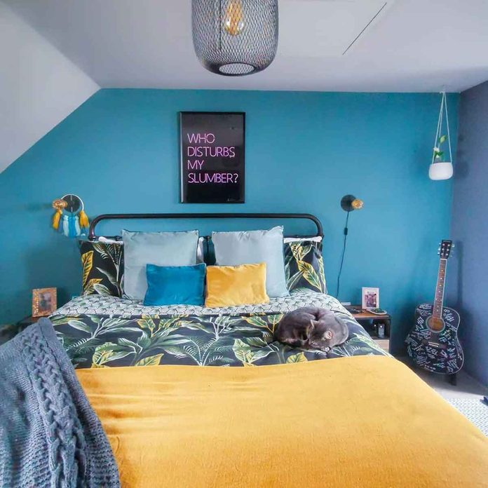 attic bedroom teal wall colorful