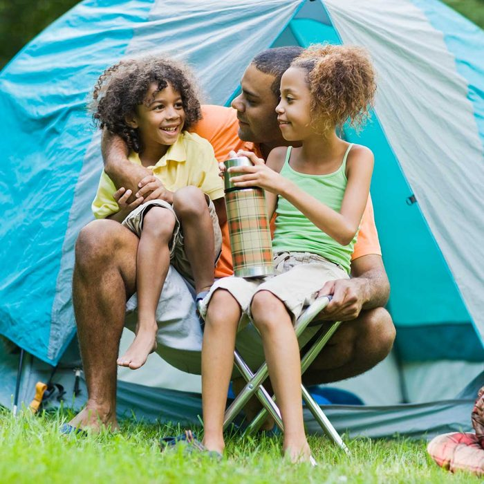 Family in front of Camping Tent