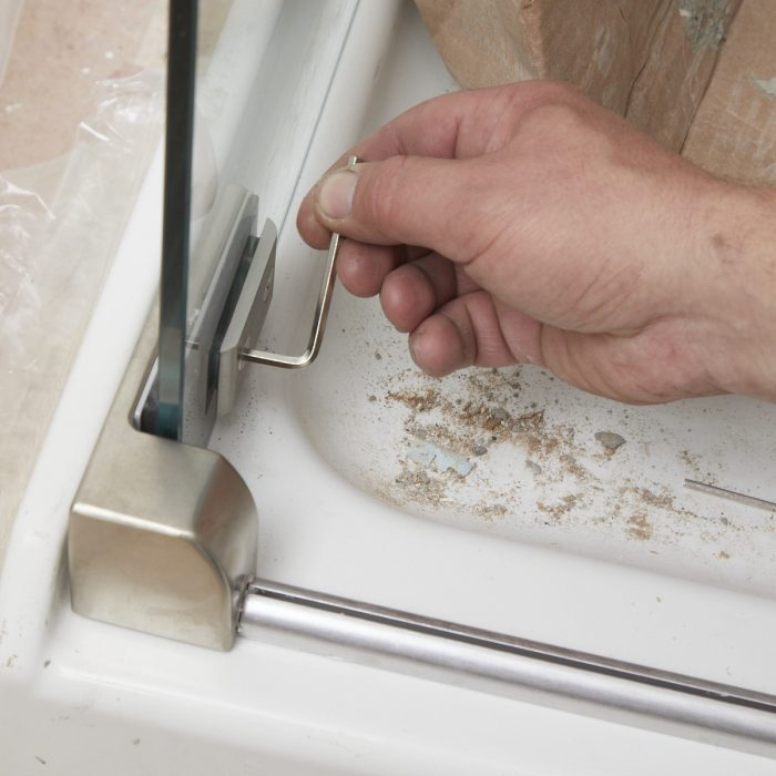 Adjusting a shower door