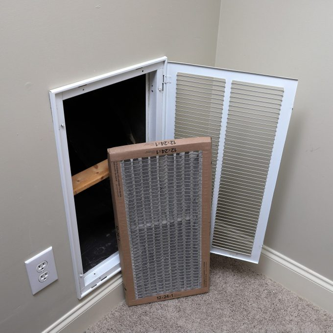 Replacing Dirty Air Filter For Air Conditioner System Maintenance
