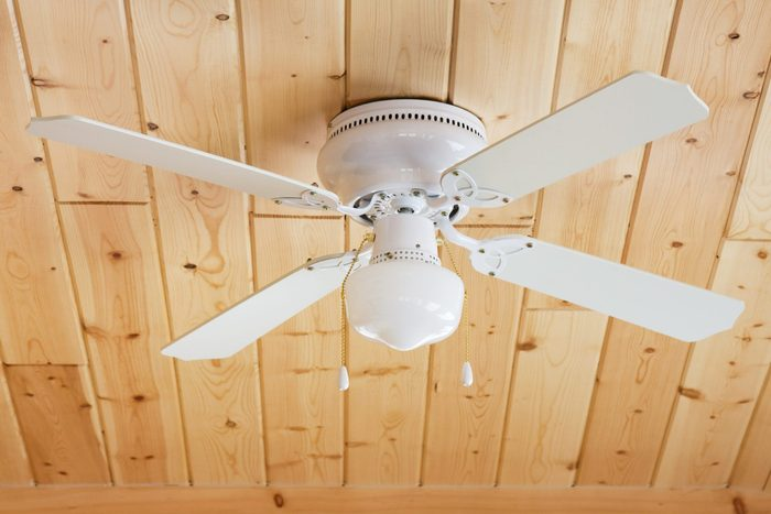 white ceiling Fan on Knotty Pine Ceiling
