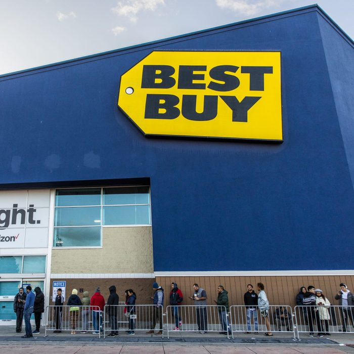 exterior of best buy store with people lined up for sale