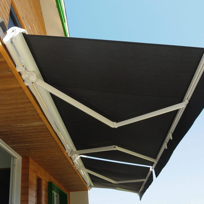 outdoor retractable awning on house