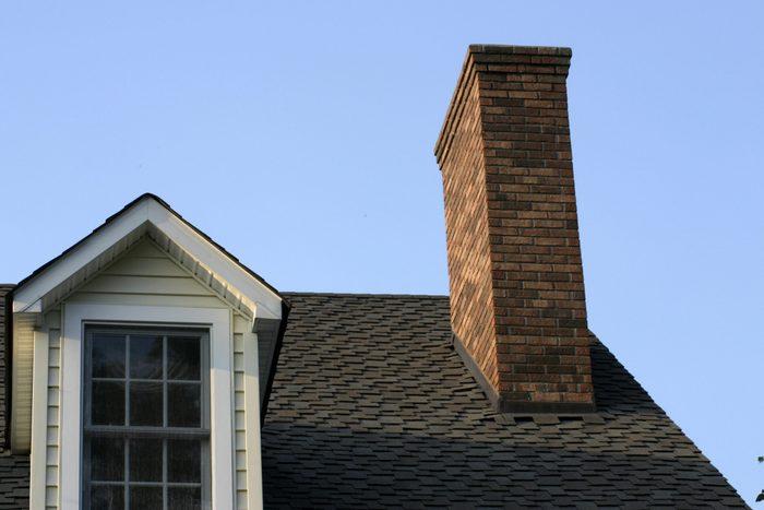 house chimney against blue sky