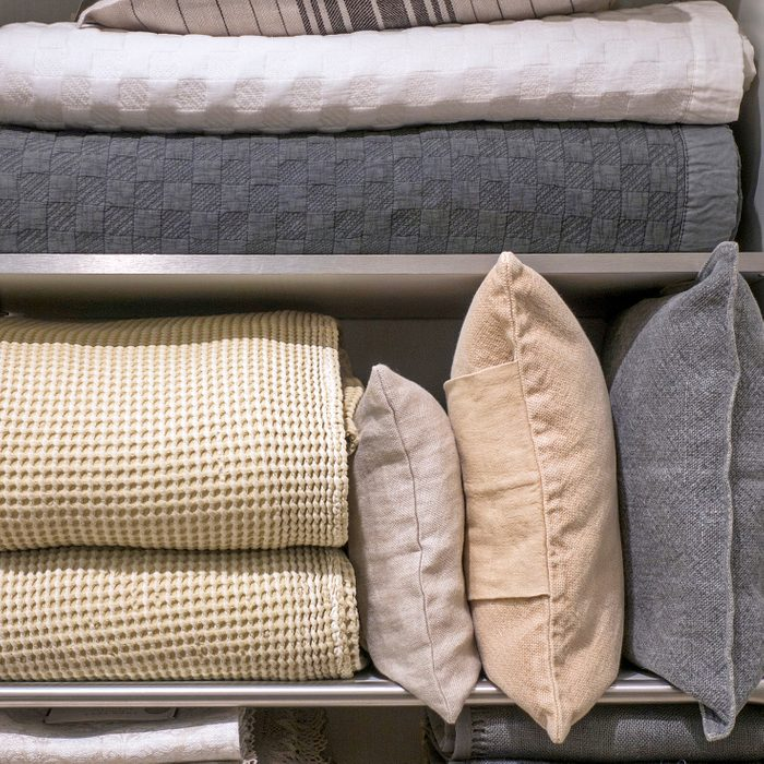blankets and quilts in the linen closet