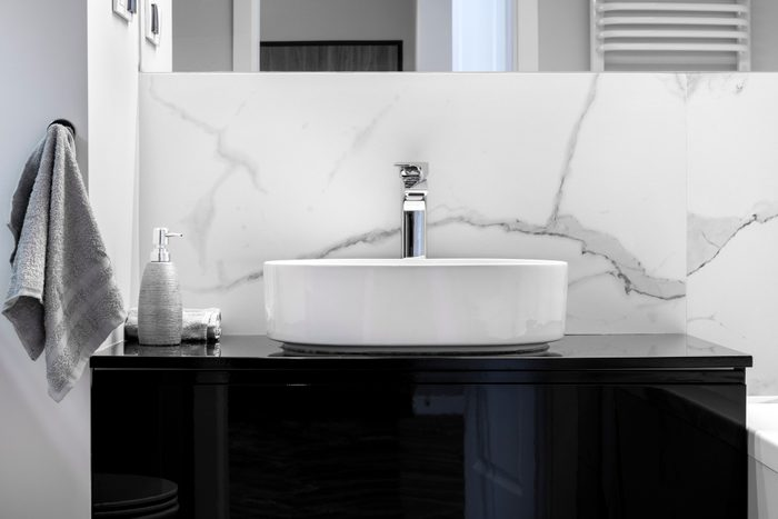 Modern bathroom with vessel sink on vanity