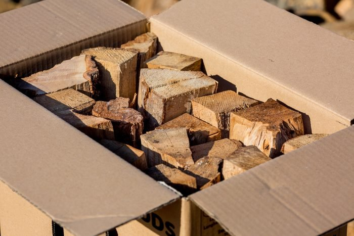 Firewood stacked in an open cardboard box