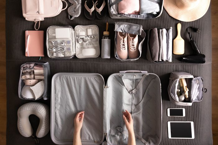 Woman Packing Suitcase For Travelling