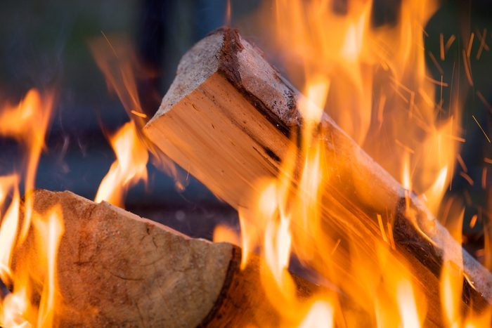 Firewood burning in fire at campground